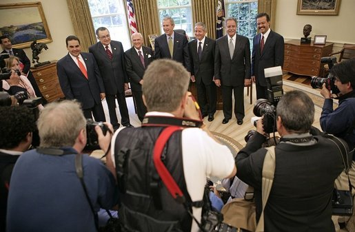 President George W. Bush poses with Presidents from Central America and the Dominican Republic in the Oval Office Thursday, May 12, 2005. From left, they are: El Salvadoran President Antonio Saca, Costa Rican President Abel Pacheco, Nicaraguan President Enrique Bolanos, Honduran President Ricardo Maduro, Guatemalan President Oscar Berger and Dominican Republican President Leonel Fernandez. White House photo by Eric Draper