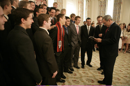 President George W. Bush talks with members of the Indiana University men's soccer team in the State Dining Room before a ceremony celebrating the 2005 NCAA champions Friday, May 13, 2005. White House photo by Eric Draper