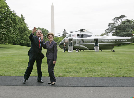 President George W. Bush and Laura Bush wave to the NCAA champions on the Truman balcony before departing the South Lawn en route Camp David Friday, May 13, 2005. White House photo by Paul Morse