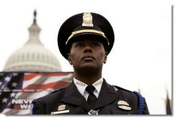 A police officer stands in front of the U.S. Capitol during the Annual Peace Officer's Memorial Service on Sunday, May 15, 2005. White House photo by Krisanne Johnson