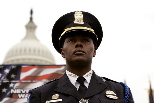 A police officer stands in front of the U.S. Capitol during the Annual Peace Officers' Memorial Service on Sunday, May 15, 2005. White House photo by Krisanne Johnson