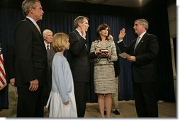 White House Chief of Staff Andrew Card swears in United States Trade Representative Rob Portman during a ceremony attended by the ambassador's family and President George W. Bush at the Dwight D. Eisenhower Executive Office Building Tuesday, May 17, 2005. White House photo by Eric Draper