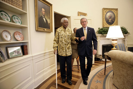President George W. Bush and former President Nelson Mandela of South Africa meet in the Oval Office Tuesday, May 17, 2005. White House photo by Eric Draper