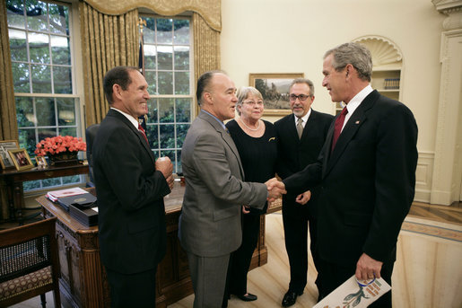 President George W. Bush meets with representatives of the Cuban-American Community in the Oval Office to discuss pro-democracy efforts in Cuba Friday, May 20, 2005. Pictured are, from left: Eleno Oviedo of Sunrise, Fla.; Luis Zuniga of Miami; Caridad Roque of Miami; and Emilio Estefan of Miami. White House photo by Eric Draper