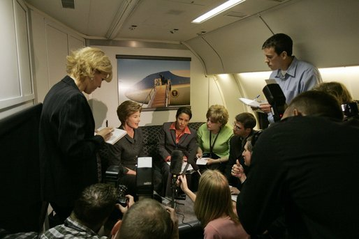 Laura Bush talks with members of the press pool aboard Air Force One during a flight to Amman, Jordan, Thursday, May 19, 2005. White House photo by Krisanne Johnson