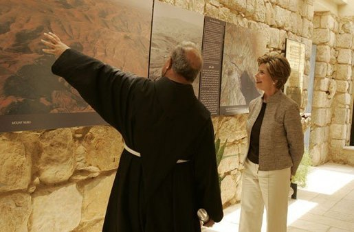 Father Michele Piccirillo, head of the Franciscan Archeology Society, gives Laura Bush a tour of the Interpretative Center at Mount Nebo in Jordan Saturday, May 21, 2005. Mount Nebo is the holy site where Moses is believed to have died. White House photo by Krisanne Johnson