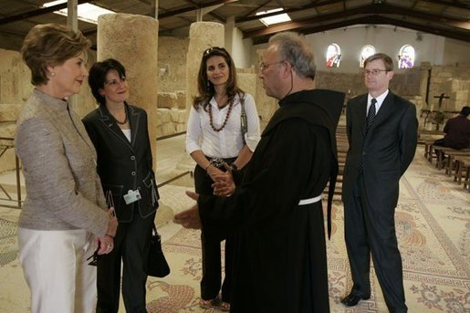 Father Michele Piccirillo, head of the Franciscan Archeology Society leads a tour for: from left, Laura Bush; Anita McBride, Mrs. Bush's Chief of Staff; Luma Kawar, the wife off the Jordanian Ambassador to the U.S.; and David Hale, the U.S. Charge in Jordan, in the Basilica on top of Mount Nebo in Jordan Saturday, May 21, 2005. White House photo by Krisanne Johnson
