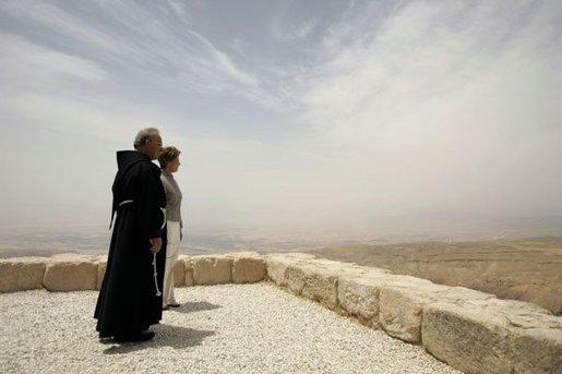 Laura Bush and Father Michele Piccirillo, head of the Franciscan Archeology Society, look out from the Judeo-Christian holy site of Mount Nebo in Jordan Saturday, May 21, 2005. White House photo by Krisanne Johnson
