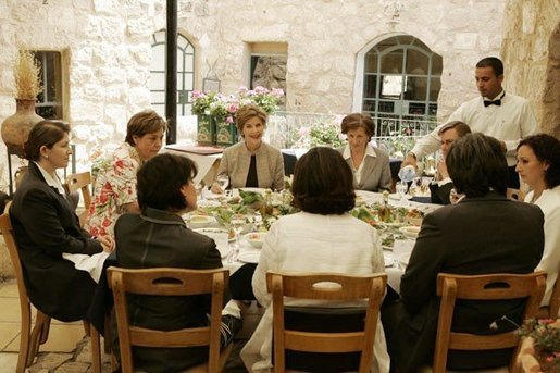 Laura Bush discusses the role of women in Jordan's reform movement with Jordanian women leaders during lunch at the Haret Jdouna restaurant in Medaba, Jordan, Saturday, May 21, 2005. White House photo by Krisanne Johnson