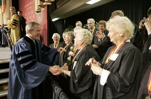 President George W. Bush greets members of the 50th anniversary class of Calvin College after giving a commencement address at Calvin College in Grand Rapids, Michigan on Saturday May 21. White House photo by Paul Morse