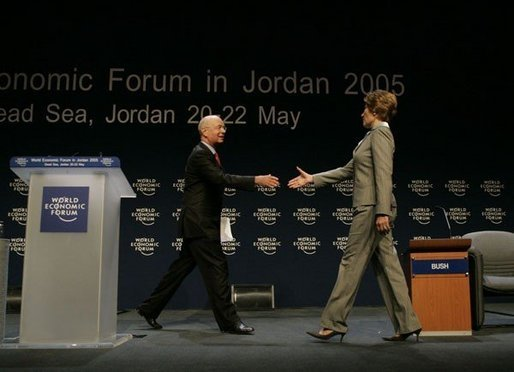 Klaus Schwab, chairman and founder of the World Economic Forum, welcomes Laura Bush to speak at the World Economic Forum at the Dead Sea in Jordan Saturday, May 21, 2005. White House photo by Krisanne Johnson
