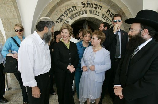 Laura Bush tours the Western Wall in Jerusalem with Rabbi Shmuel Rabinowitz; Gila Katsav, wife of Israeli President Moshe Katsav, center; and Mordechai Suli Eliav, manager of The Western Wall Heritage Foundation, May 22, 2005. White House photo by Krisanne Johnson