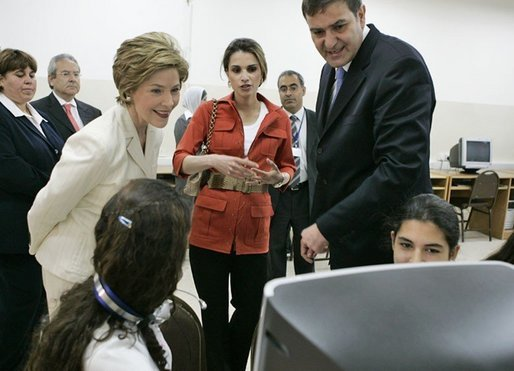 Laura Bush and Queen Raina Al-Abdullah, wife of King Abdullah of Jordan, center, talk with students during a computer lab at the Discovery School of Swaifiyeh Secondary School in Amman, Jordan, Sunday, May 22, 2005. White House photo by Krisanne Johnson
