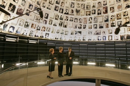 Laura Bush tours the Hall of Names with Gila Katsav, wife of President Moshe Katsav of Israel, left, and General Avner Shalev, chairman of the Yad Vashem Directorate, right, at the Yad Vashem Holocaust museum in Jerusalem, Sunday, May 22, 2005. The Hall of Names is a repository of testimony from millions of Holocaust victims and serves as a memorial to those who died. White House photo by Krisanne Johnson