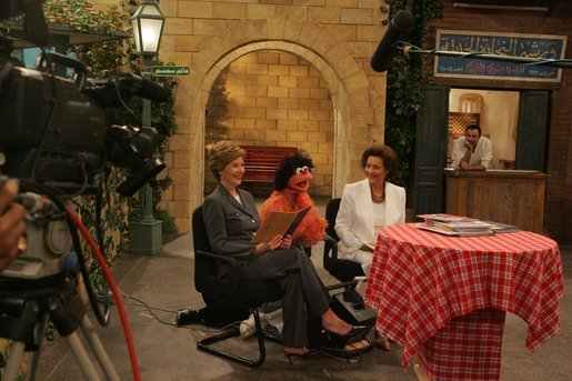 "Laura Bush and Suzanne Mubarak appear as guests on the Egyptian children's television program ""Alam Simsim"" with the show's character Khokka at Studio Misr in Cairo, Egypt, Monday, May 23, 2005. White House photo by Krisanne Johnson"