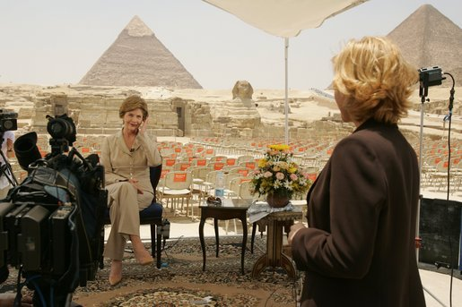 Press Secretary Susan Whitson talks with Laura Bush between television interviews in front of the Giza Pyramids in Giza, Egypt, Monday, May 23, 2005. White House photo by Krisanne Johnson