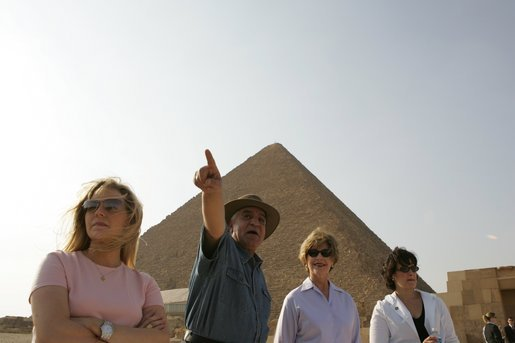 Dr. Zahi Hawass, secretary general of the Supreme Council of Antiquities, shows Liz Cheney, left, Laura Bush and Anita McBride, chief of staff for Mrs. Bush, right, the Giza Pyramids and a new excavation site in Giza, Egypt, Monday, May 23, 2005. White House photo by Krisanne Johnson