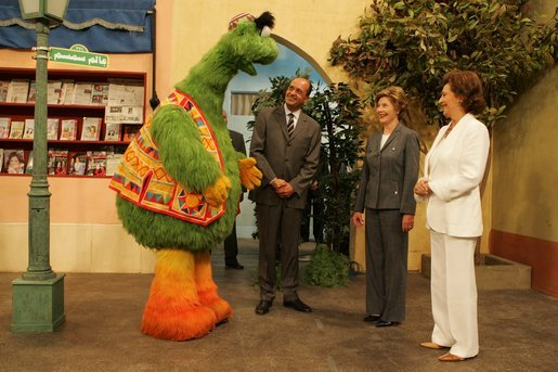 "Laura Bush and Suzanne Mubarak, wife of Egyptian President Hosni Mubarak, right, meet children's television character Nimnim, left, and Amr Koura, CEO of Alkarma Endutainment, before taking a segment for the ""Alam Simsim"" show in Cairo, Egypt, May 23, 2005. The program offers educational curriculum in an inventive way that puts fun into learning for Egyptian children. White House photo by Krisanne Johnson"