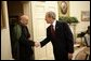 President George W. Bush welcomes Afghanistan President Hamid Karzai into the Oval Office Monday, May 23, 2005, following his arrival to the White House.  White House photo by Eric Draper
