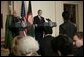 President George W. Bush and Afghan President Hamid Karzai field a question from a reporter Monday, May 23, 2005 in the East Room of the White House. White House photo by Eric Draper