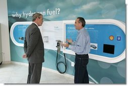 President George W. Bush is led by Rick Scott, Operations and Safety Coordinator, Shell Hydrogen, L.L.C., through the visitor center exhibit at a Washington D.C. Shell Service Station equipped with a hydrogen fueling station Wednesday, May 25, 2005. The station is the first integrated gasoline/hydrogen station in North America and will service a fleet of six GM fuel cell vehicles, which were developed in collaboration with the Department of Energy.  White House photo by Paul Morse