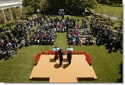 President George W. Bush and President Mahmoud Abbas of the Palestinian Authority, shake hands after a joint press availability in the Rose Garden of the White House Thursday, May 26, 2005.  White House photo by Paul Morse