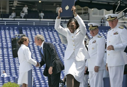 A U.S. Naval Academy graduate yells for joy after receiving her diploma in Annapolis, Md., Friday, May 27, 2005. White House photo by Paul Morse