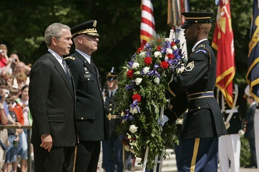 President George. W. Bush stands with U.S. Army Major General Galen Jackman as he lays a wreath at the Tomb of the Unknown Soldier at the Arlington National Cemetery on Memorial Day May 30, 2005. White House photo by Krisanne Johnson