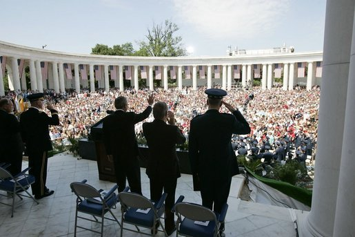President George W. Bush, Secretary of Defense Donald Rumsfeld and Chairman of the Joint Chiefs of Staff General Richard Meyers participate in a Memorial Day ceremony at the Arlington National Cemetery amphitheatre in Arlington, Va., May 30, 2005. White House photo by Paul Morse