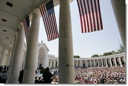 Thousands of people gather to pay their respects on Memorial Day at the amphitheatre in Arlington National Cemetery in Arlington, Va., May 30, 2005.  White House photo by Paul Morse