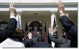 President George W. Bush points to raised hands as he fields a question from the media during a press availability Tuesday, May 31, 2005, in the Rose Garden of the White House. White House photo by Eric Draper