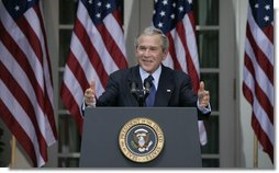 President George W. Bush smiles as he responds to a reporter's question Tuesday morning, May 31, 2005, during a press availability in the Rose Garden of the White House. White House photo by Eric Draper