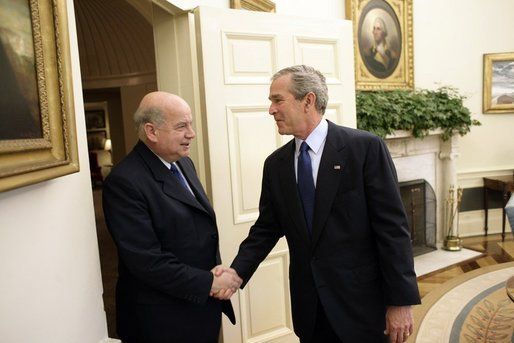 President George W. Bush welcomes Dr. Jose Miguel Insulza, Secretary General of the Organization of American States, to the Oval Office of the White House Tuesday, May 31, 2005. The former Chilean interior minister assumed the OAS office May 26, 2005. White House photo by Eric Draper