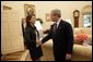 President George W. Bush welcomes Maria Corina Machado, the founder and executive director of Sumate, an independent democratic civil society group in Venezuela, to the Oval Office Tuesday, May 31, 2005.