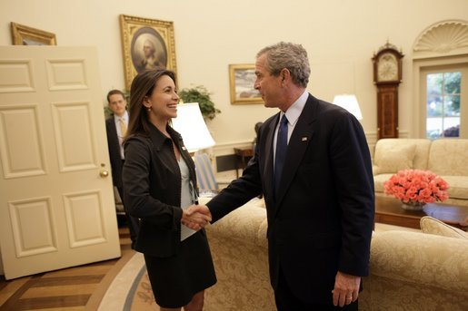 President George W. Bush welcomes Maria Corina Machado, the founder and executive director of Sumate, an independent democratic civil society group in Venezuela, to the Oval Office Tuesday, May 31, 2005. Sumate was established in January 2002 as a non-governmental organization to defend the electoral and constitutional rights of all Venezuelan citizens and to monitor and report on the performance of Venezuela's electoral institutions. White House photo by Eric Draper