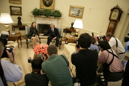 President George W. Bush meets with Maria Corina Machado in the Oval Office of the White House Tuesday, May 31, 2005. Ms. Machado is the founder and executive director of Sumate, an independent democratic civil society group in Venezuela. White House photo by Eric Draper