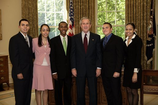 "President George W. Bush stands with the 2004 Boys & Girls Club of America's Youth of the Year finalists in the Oval Office Wednesday, June 1, 2005. From left are: Ramon Moran of Tucson, Ariz.; Noelia Bare of Lawrence, Mass.; Stephen Miller of Mobile, Ala.; President Bush; Thomas ""T.J."" Rancour of Bay County, Mich., and Danielle Snead of San Antonio. White House photo by Eric Draper"