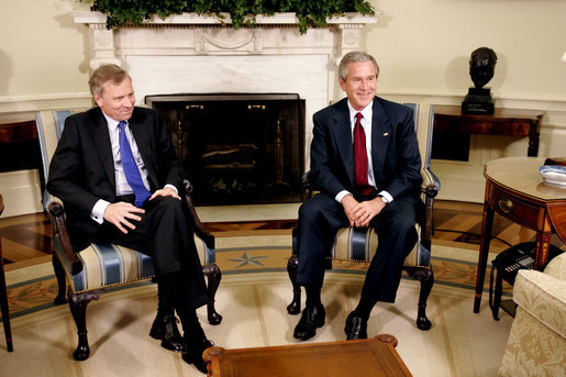 President George W. Bush and Jaap de Hoop Scheffer, Secretary General of NATO, sit for the media in the Oval Office of the White House Wednesday, June 1, 2005. White House photo by Paul Morse