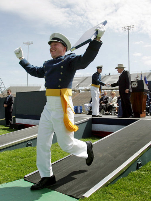 A cadet celebrates after receiving his diploma from the U.S. Air Force Academy in Colorado on Wednesday, June 1, 2005. Vice President Dick Cheney delivered the commencement address and personally congratulated the newly-commissioned officers. White House photo by David Bohrer