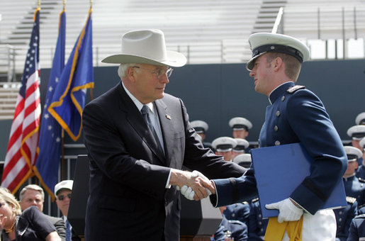 Vice President Dick Cheney shakes hands with Andrew Sellers, the first graduate to receive his diploma in the U.S. Air Force Academy Class of 2005, during the commencement ceremony in Colorado on Wednesday, June 1, 2005. The graduate was deemed the outstanding cadet for academic performance, military performance and in the field of computer science. White House photo by David Bohrer