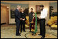 President George W. Bush greets 11-year-old Vasila Hossaini in the Diplomatic Reception Room of the White House Thursday, June 2, 2005. The Afghan youth recently underwent surgery to correct a congenital heart defect that allows un-oxygenated blood to circulate through her body. Project Kids Worldwide, a non-profit organization, that helps provide surgery and other medical care to impoverished children suffering from heart defects, helped to arrange the meeting with the President. With her is her father, Arman, in dark jacket; filmmaker Stacia Teele, who is documenting Vasila's illness and trip, and Hameed Said, their interpreter. White House photo by Paul Morse