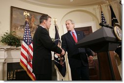 President George W. Bush shakes the hand of Christopher Cox (R-Calif.) after introducing him Thursday, June 2, 2005, as his nominee for Chairman of the Securities and Exchange Commission. White House photo by Paul Morse