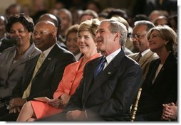 President George W. Bush, Laura Bush and HUD Secretary Alphonso Jackson, pictured at right, listen to performers during the White House reception honoring June as Black Music Month in the East Room Monday, June 6, 2005.  White House photo by Paul Morse