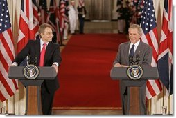 "President George W. Bush and British Prime Minister Tony Blair hold a joint press conference in the East Room Tuesday, June 7, 2005. ""Prime Minister Blair and I share a common vision of a world that is free, prosperous, and at peace,"" said President Bush. ""When men and women are free to choose their own governments, to speak their minds, and to pursue a good life for their families, they build a strong, prosperous and just society.""  White House photo by Paul Morse"