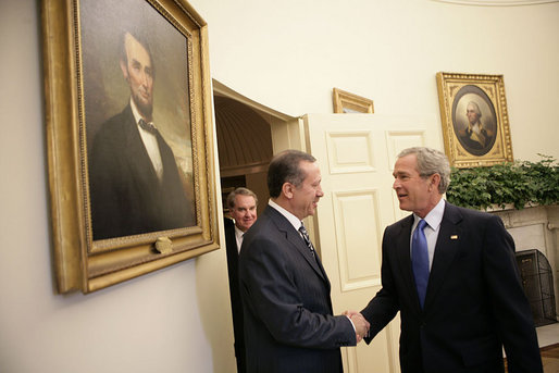 "President George W. Bush welcomes Prime Minister Recep Tayyip Erdogan of Turkey to the Oval Office Wednesday, June 8, 2005. ""Turkey's democracy is an important example for the people in the broader Middle East, and I want to thank you for your leadership,"" said the President in his remarks during the two leaders' meeting with the press. White House photo by Eric Draper"