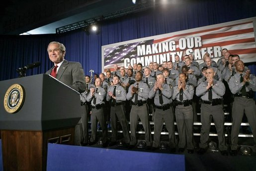 President George W. Bush receives a standing ovation from members of the Ohio State Highway Patrol before delivering remarks on the Patriot Act at in Columbus, Ohio, Thursday, June 9, 2005. White House photo by Eric Draper