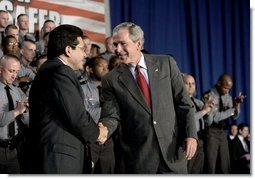 President George W. Bush thanks Attorney General Alberto Gonzales after speaking about the Patriot Act at the Ohio State Highway Patrol Academy in Columbus, Ohio, Thursday, June 9, 2005.  White House photo by Eric Draper