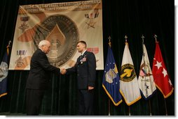 Vice President Dick Cheney awards U.S. Air Force Major Matthew R. Glover the Distinguished Flying Cross during the Heroism Awards Ceremony at the Davis Conference Center, MacDill Air Force Base, in Tampa, Fla., Friday, June 10, 2005. White House photo by David Bohrer