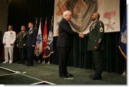 Vice President Dick Cheney awards U.S. Army Sgt. 1st Class Stephan Johns the Silver Star during the Heroism Awards Ceremony at the Davis Conference Center, MacDill Air Force Base, in Tampa, Fla., Friday, June 10, 2005.  White House photo by David Bohrer