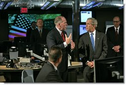 "President George W. Bush tours the National Counterterrorism Center in McLean, Va., Friday, June 10, 2005. ""I just met with some (of the men and women) who spend long hours preparing threat assessments, and it was my honor to tell them how much I appreciate their hard work and appreciate the daily briefing I get every single morning,"" said the President in his remarks after the tour.  White House photo by Eric Draper"